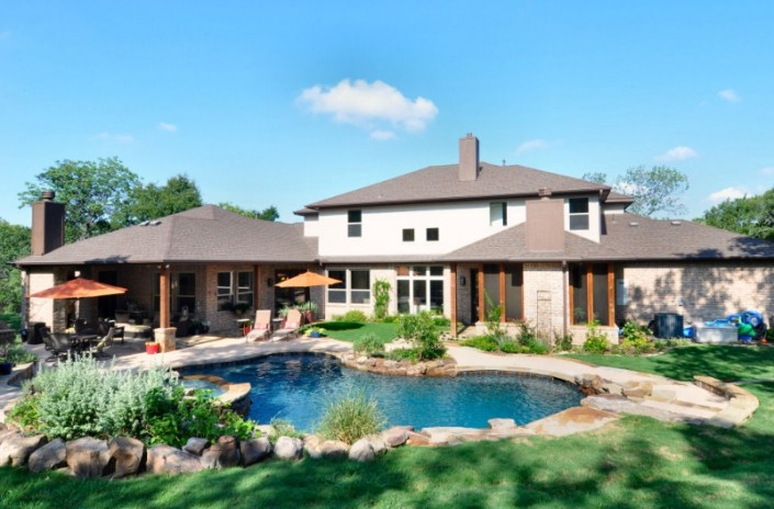 Backyard with pool natural layout Sterling Brook Custom Homes